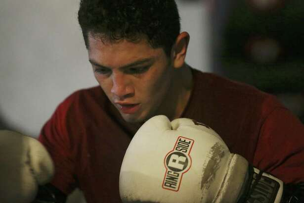 "Cresencio Ramos Jr. works out at the Premier Boxing Club on Oct. 12, 2016. Ramos is a junior at UTSA studying kinesiology. Ramos, 22, is also a boxer whose alias is ""Kid Thunder,"" and has nine professional fights with no losses."