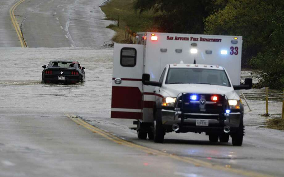 A reader fears population growth will exacerbate problems related to inadequate infrastructure, such as flooding. This month, rescue crews help a driver and a passenger whose car got stuck in high water along West Commerce Street and Pinn Road. Photo: Kin Man Hui /San Antonio Express-News / ©2016 San Antonio Express-News