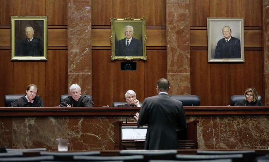 Texas Supreme Court justices listen as an attorney argues his case. A creditable justice system is fundamental to justice for all. But a recent survey from the National Center for State Courts reflects a strong public perception that some people do not receive fair treatment in our courts. Photo: Eric Gay /Associated Press / AP
