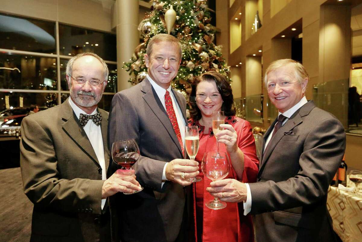 David and Tara Wuthrich, center, chairs of Houston Symphony's 2017 Wine Dinner and Collector's Auction, Bob Weiner, left, and Jesse Tutor
