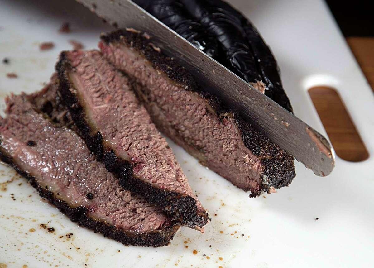 Grant Pinkerton slices prime brisket at Pinkerton's Barbecue.