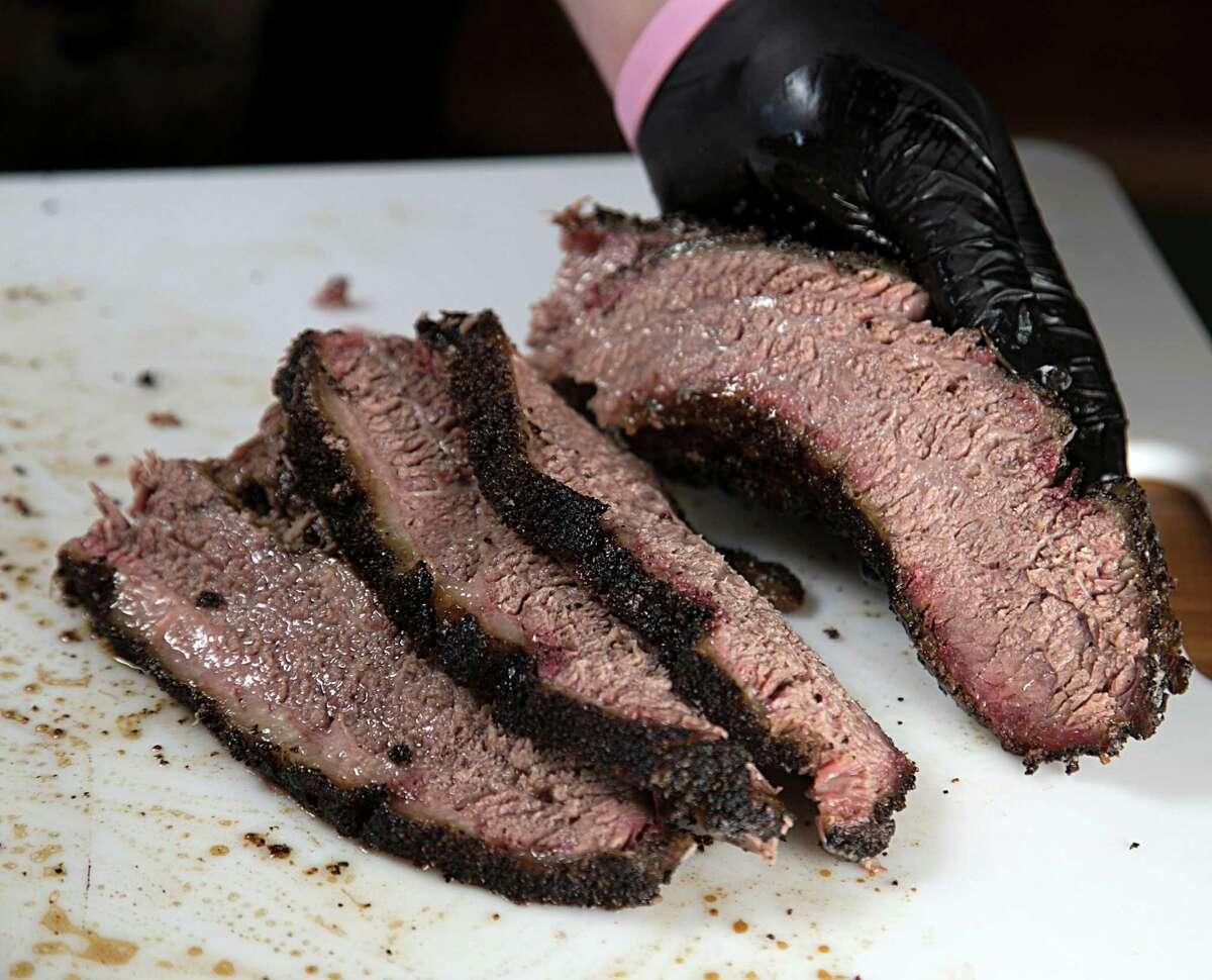 Grant Pinkerton slices prime brisket at Pinkerton's Barbecue Dec. 6, 2016, in Houston. ( James Nielsen / Houston Chronicle )