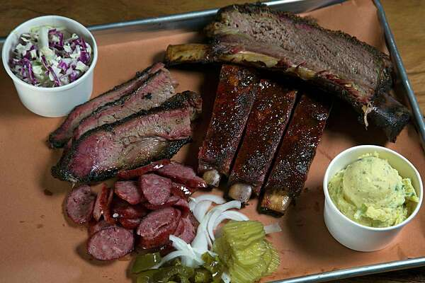 Beef rib, prime brisket, jalapeno sausage, glazed pork ribs, cole slaw and potato salad at Pinkerton's Barbecue Dec. 6, 2016, in Houston. ( James Nielsen / Houston Chronicle )