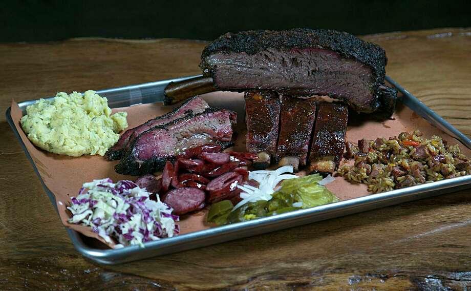 Beef rib, prime brisket, jalapeno sausage, glazed pork ribs, cole slaw, potato salad and duck jambalaya at Pinkerton's Barbecue Photo: James Nielsen, Staff / © 2016  Houston Chronicle