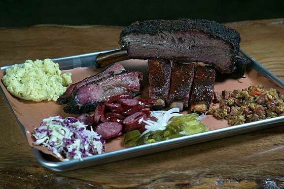 Beef rib, prime brisket, jalapeno sausage, glazed pork ribs, cole slaw, potato salad and duck jambalaya at Pinkerton's Barbecue