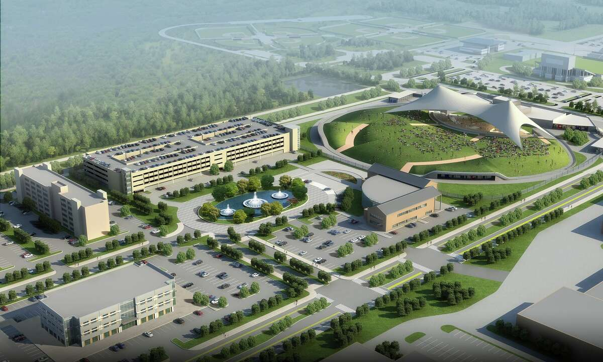 This rendering of Valley Ranch Town Center's entertainment district shows the proposed location of a new East Montgomery County Improvement District facility. The proposed facility is represented by the building with the rounded front to the right of the fountains and to the left of the amphitheater. The actual shape of the new facility is not yet determined.
