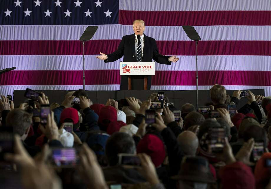 President-elect Donald Trump stumps for Republican candidates for Congress at the Dow Chemical Hangar in Baton Rouge, La. Photo: Drew Angerer, Getty Images
