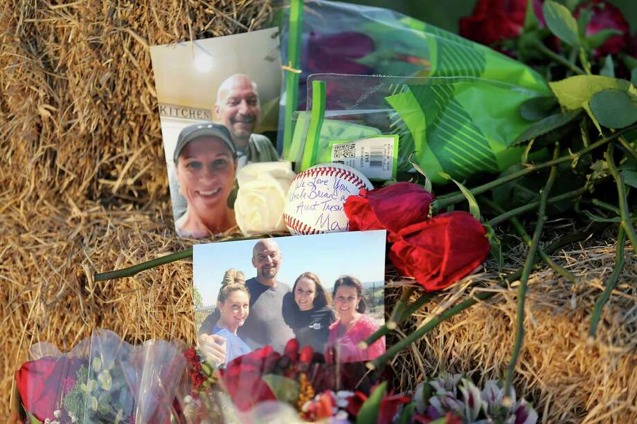 A view of photos, a baseball, and roses left at a memorial Monday Aug. 1, 2016 at the site of a hot air balloon crash that killed 16 people on Saturday July 30, 2016 near Maxwell, Texas in Caldwell County. Photo: Edward A. Ornelas, Staff / San Antonio Express-News / © 2016 San Antonio Express-News