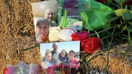 A view of photos, a baseball, and roses left at a memorial Monday Aug. 1, 2016 at the site of a hot air balloon crash that killed 16 people on Saturday July 30, 2016 near Maxwell, Texas in Caldwell County.