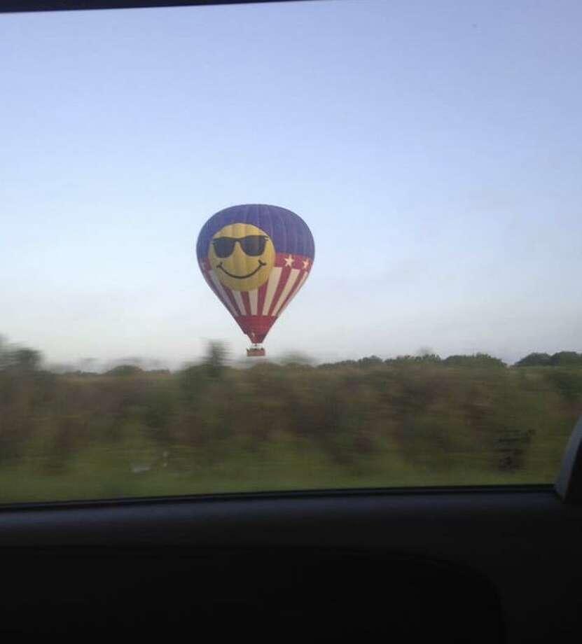 Tamara Calhoun captured this photo of the hot air balloon that crashed in Lockhart, Texas. All 16 passengers on board died when the hot air balloon hit power lines. Photo: Tamara Irish Calhoun / handout