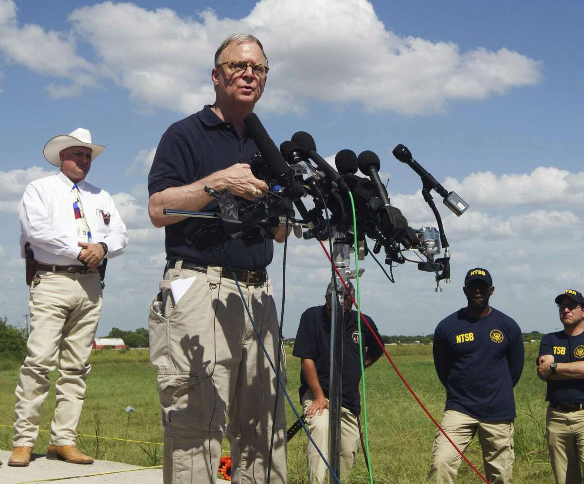 NTSB member, Robert Sumwalt speaks at a press conference at the site of Saturday's hot air balloon crash near Lockhart, Texas, July 31, 2016. The crash prompted a law for which the FAA has so far failed to make rules public.