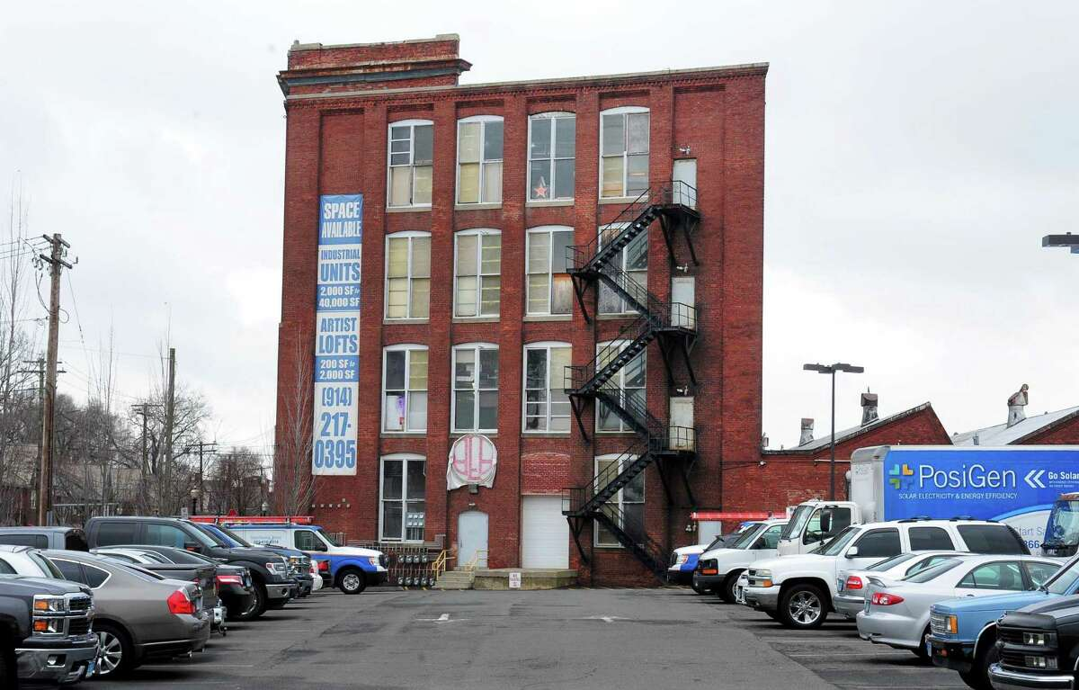 An exterior view of the former American Fabric complex on Connecticut Ave in Bridgeport, Conn. on Wednesday Dec. 7, 2016. Safety is a priority at the complex and is on the minds of many artists who use the spaces here since the recent fatal fire at an art space in Oakland, CA. The American Fabrics Arts Building (AFA) Open Studios rents space to over 25 artists, which is in a renovated factory building where linen and lace were once manufactured.