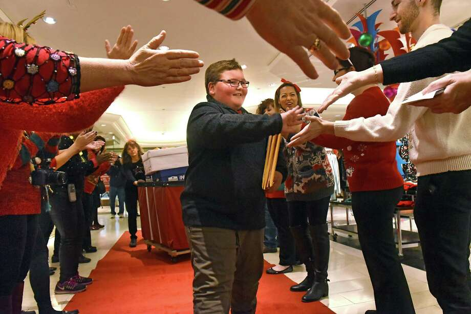"Luke Hoag from Hoosick Falls, 9, is greeted by Macy's employees dressed in ugly Christmas sweaters as he delivers more than 40,000 Santa letters at Macy's Colonie on ""Believe Day"" Friday, Dec. 9, 2016 in Colonie, N.Y. Luke was delivering the letters to a red letterbox at Macy's to help support Make-A-Wish through Macy's annual Believe campaign  (Lori Van Buren / Times Union) Photo: Lori Van Buren / 20039089A"
