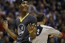 Golden State Warriors' Patrick McCaw (0) reacts to a foul call during the second half of an NBA basketball game against the Milwaukee Bucks, Saturday, Nov. 19, 2016, in Milwaukee. The Warriors won 124-121. (AP Photo/Aaron Gash)