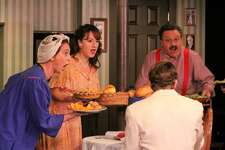 """The role of food in Italian American family life is depicted in the musical number """"Pasta Pushin' Mama"""" in """"A Merry Mulberry Street Musical"""" at Curtain Call theater in Stamford through Dec. 17. Shown here are (left to right) Gail Yudain, Dana DiCerto, and Lou Ursone. In the foreground is Joe Efferen."""