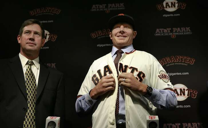 Giants General Manager Bobby Evans, (left) was on hand as the San Francisco Giants introduced their newly acquire pitcher Matt Melancon, at AT&T Park in San Francisco, California, on Friday  December 9, 2016.