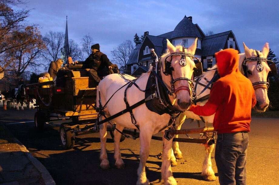 Horse-drawn carriage rides through Southport Village will be a highlight of the Holiday Caroling Party & Open House at the Pequot Library Friday, Dec. 16, in Fairfield. Photo: Mike Lauterborn / Contributed Photo