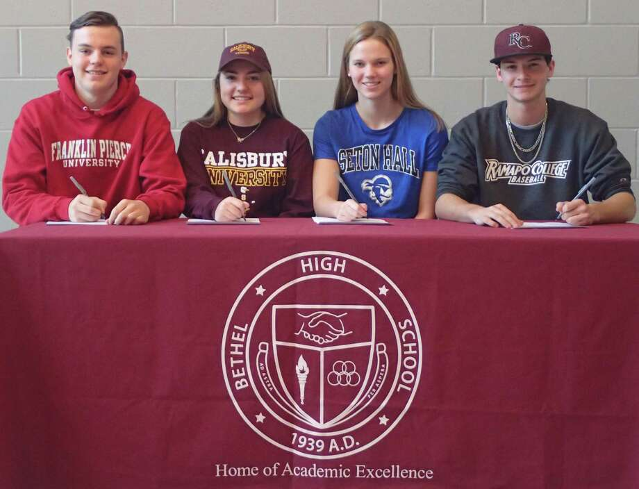Four Bethel High School student-athletes finalized their college plans during a signing-day ceremony at the school Dec. 9, 2016. From left, Luke Newman will attend Franklin Pierce and play lacrosse; Ariana Leggio will attend Salisbury University and play tennis; Amelia Wootton will attend Seton Hall University and compete with the swimming and diving team; and Stephen Spinella will attend Ramapo College and play baseball. Photo: Richard Gregory / Richard Gregory