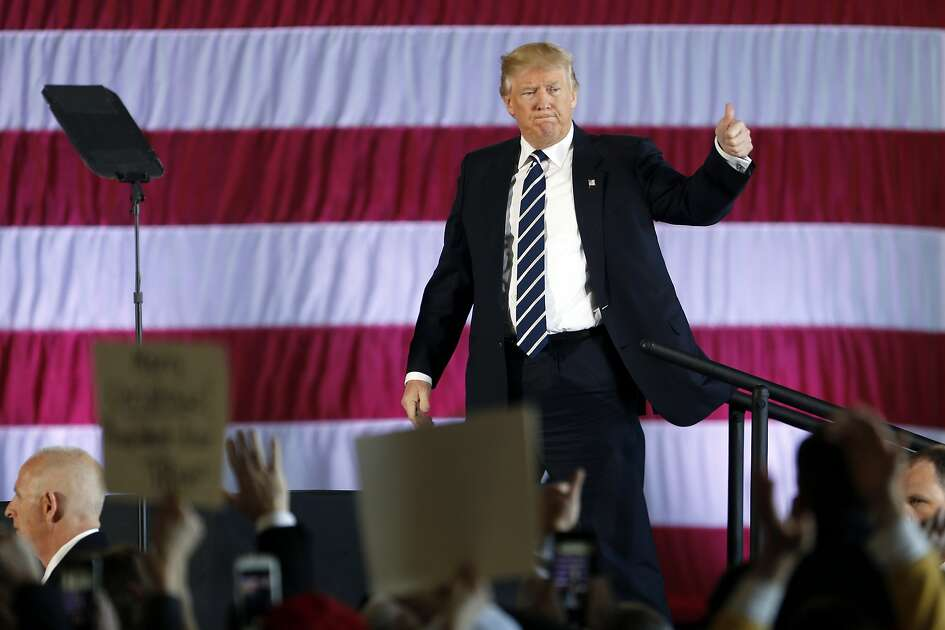 President-elect Donald Trump waves after speaking at a rally in Baton Rouge, La., Friday, Dec. 9, 2016. (AP Photo/Gerald Herbert)
