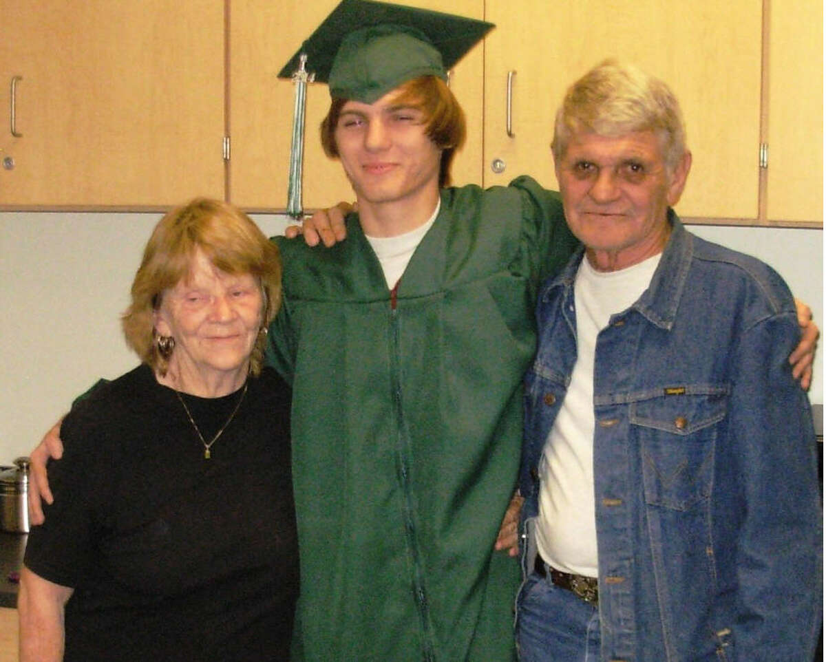 Matthew McCoy, who died April 12, 2016, following a highway construction zone crash, is shown with his grandparents, Kaye and Joe McCoy, following his high school graduation on Dec. 17, 2014.