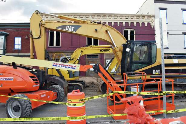 Demolition of the Caroline Street building damaged by the Thanksgiving Day fire is postponed again Friday Dec. 9, 2016 in Saratoga Springs, NY.  (John Carl D'Annibale / Times Union)