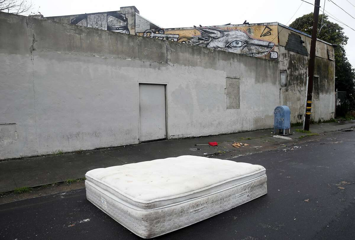 A mattress is abandoned on Espee Avenue in front of the Burnt Ramen underground music club in Richmond, Calif. on Friday, Dec. 9, 2016. Mayor Tom Butt described the venue as Richmond's version of the Ghost Ship, the Oakland artist collective where 36 people died in a fire during an electronic music party last weekend.