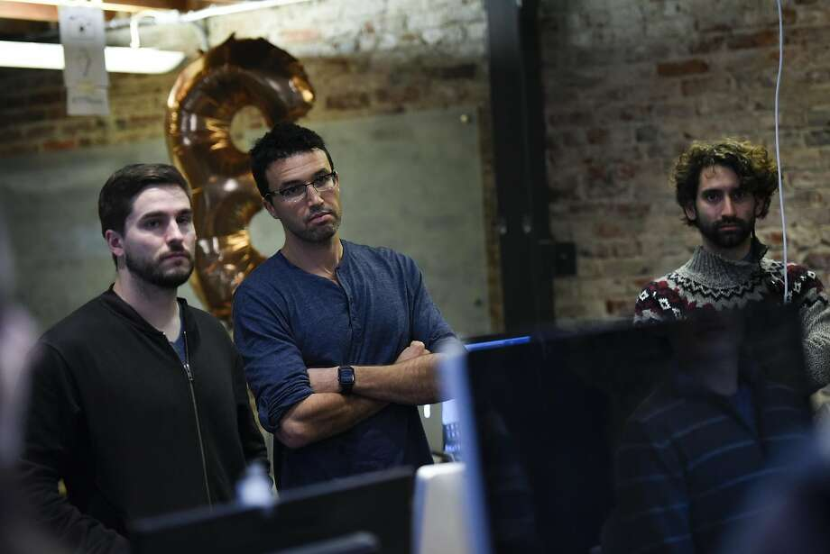 Jesse Pickard, center, is the creator of the award-winning Elevate app and also is the founder of the group Debug Politics. Photo: Michael Short, Special To The Chronicle