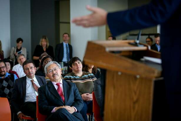 Ed Lee listens while CEO of Salesforce Marc Benioff speaks at the press conference announcing the Heading Home campaign on Friday, December 9, 2016 in San Francisco, Calif.