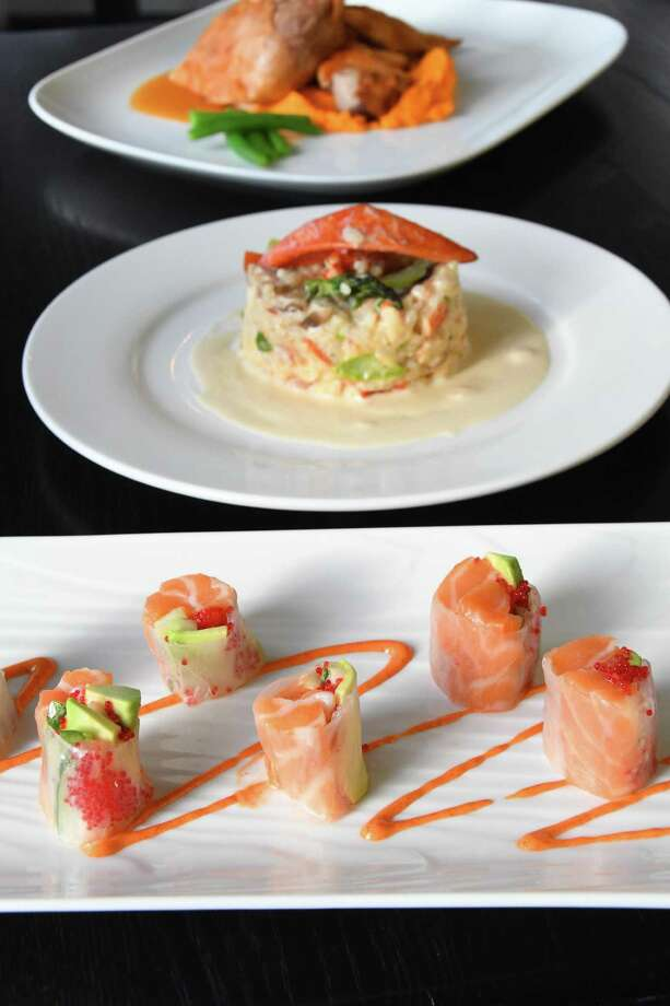 Some of the delectable dishes served at the Beach House Cafe in Greenwich are salmon summer roll, foreground, lobster risotto and crackling duck with carrot ginger puree. Photo: Bradley E. Clift / For Hearst Connecticut Media / All images produced are owned by Bradley E. Clift  © 2016  Any use beyond Hearst Media must have written permission from copyrig
