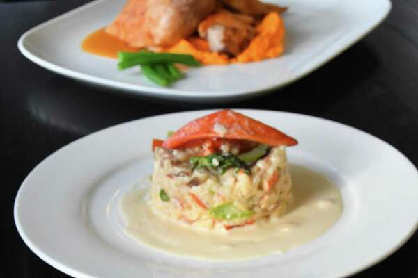 Some of the delectable dishes served at the Beach House Cafe in Greenwich are salmon summer roll, foreground, lobster risotto and crackling duck with carrot ginger puree.