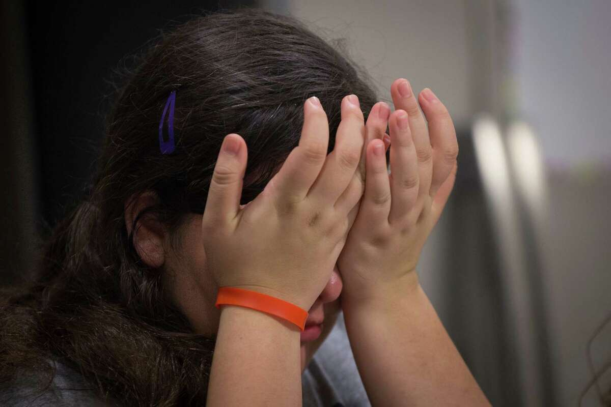 Alexia Stamatis, 13, becomes frustrated and starts to cry after not being able to peel a cucumber, Wednesday, Dec. 7, 2016. Stamatis has been diagnosed with hypotonia, autism and epilepsy. Tasks that require fine motor control are a source of anxiety for Stamatis who is on seventh grade student at West Memorial Junior High School in Katy.