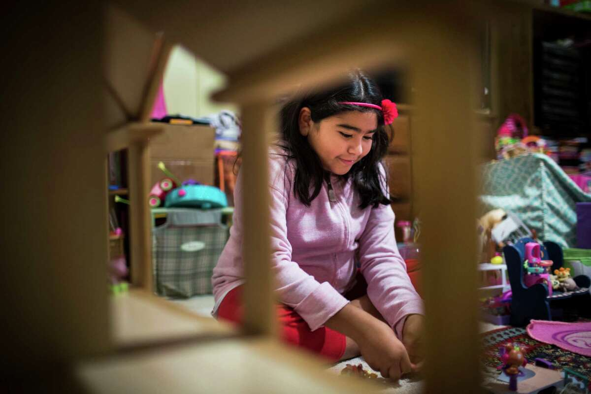 Ashley Rodriguez, 9, plays with her toys in her parents bedroom after dinner, Monday, Dec. 5, 2016, in Pflugerville. Rodriguez is a fifth grader who recently got placed in special education after years of struggles by her parents to get her services. The school refused to provide special education. Rodriguez's parents were told that immigrants could not get special ed and that they couldn't fight it.