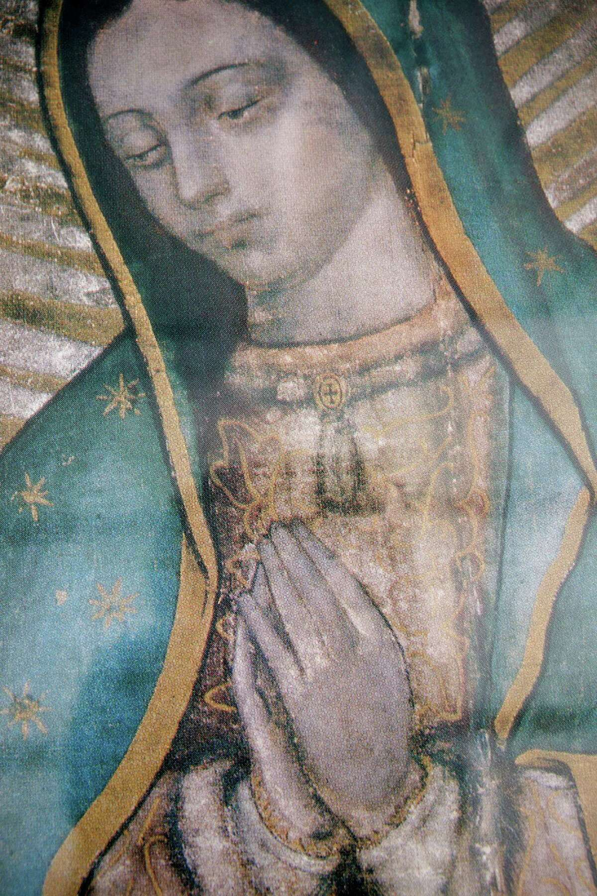 A detail of a copy of a painting of Our Lady of Guadalupe on Friday, Dec. 9, 2016, in Houston. The association has had the painting of Our Lady of Guadalupe since 2008.