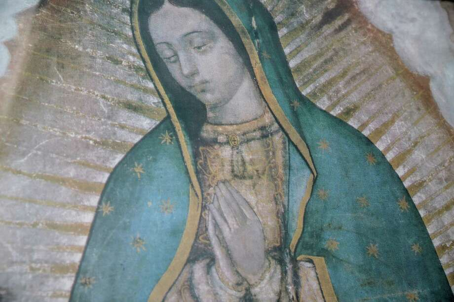 A detail of a copy of a painting of Our Lady of Guadalupe  on Friday, Dec. 9, 2016, in Houston. The association has had the painting of Our Lady of Guadalupe since 2008. Photo: Elizabeth Conley, Houston Chronicle / © 2016 Houston Chronicle