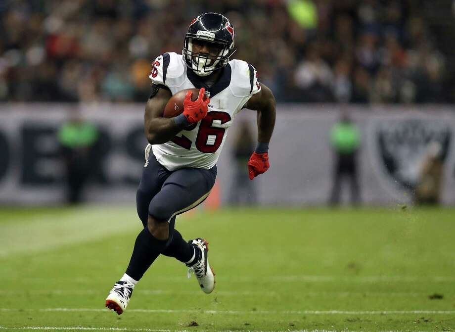 Lamar Miller is averaging a combined 21.1 touches per game on 225 carries for 903 yards and three touchdowns and 28 receptions for 147 yards and one score. Photo: Buda Mendes, Getty Images / 2016 Getty Images
