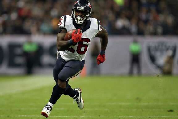 MEXICO CITY, MEXICO - NOVEMBER 21:   Lamar Miller #26 of the Houston Texans rushes the ball against the Oakland Raiders at Estadio Azteca on November 21, 2016 in Mexico City, Mexico.