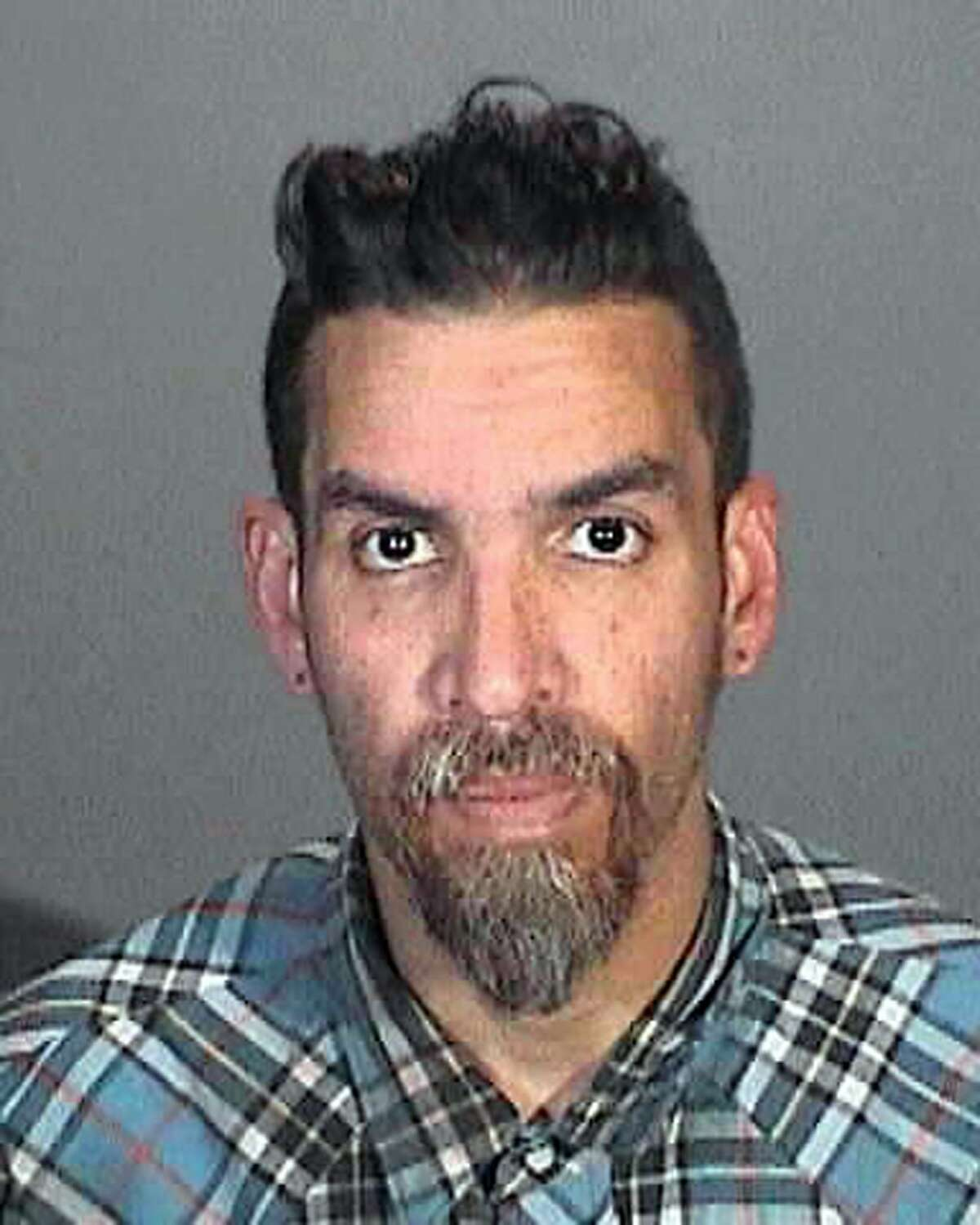 This March 12, 2015 booking photo provided by the Glendale, Calif., Police Department shows Derick Ion Almena. Almena is an operator of the Ghost Ship warehouse in Oakland, in which dozens of people died in a fire that started Dec. 2, 2016. Spokeswoman Tawnee Lightfoot says Almena was stopped for driving with expired registration and, after a consensual search, two license plates from Oakland-area stolen cars were found. The charges apparently were not pursued. (Glendale Police Department via AP)