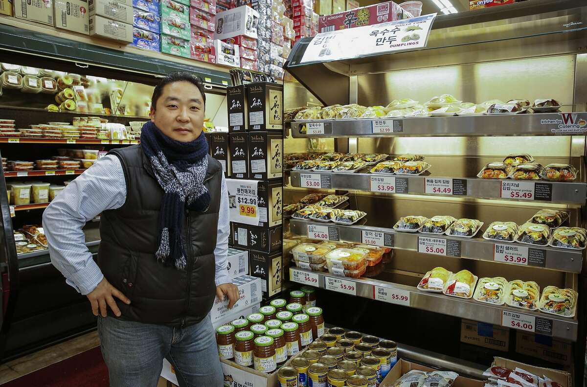 Eric Hak Kim, owner of Woori Market, stands by their gimbap (Korean sushi) case on Friday, Dec. 9, 2016 in San Francisco, Calif. The gimbap is made fresh in the market's kitchen.
