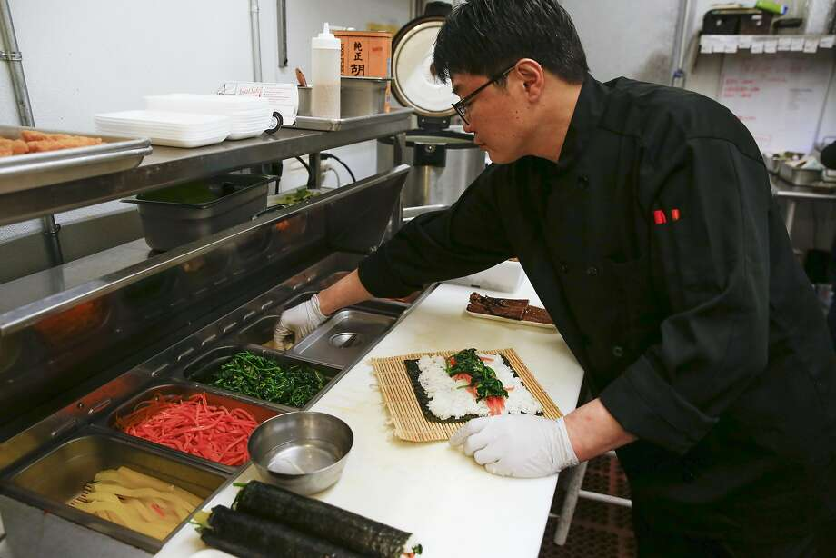 Chef Basilio Gang makes burdock gimbap in the Woori Market kitchen in S.F. Photo: Russell Yip, The Chronicle