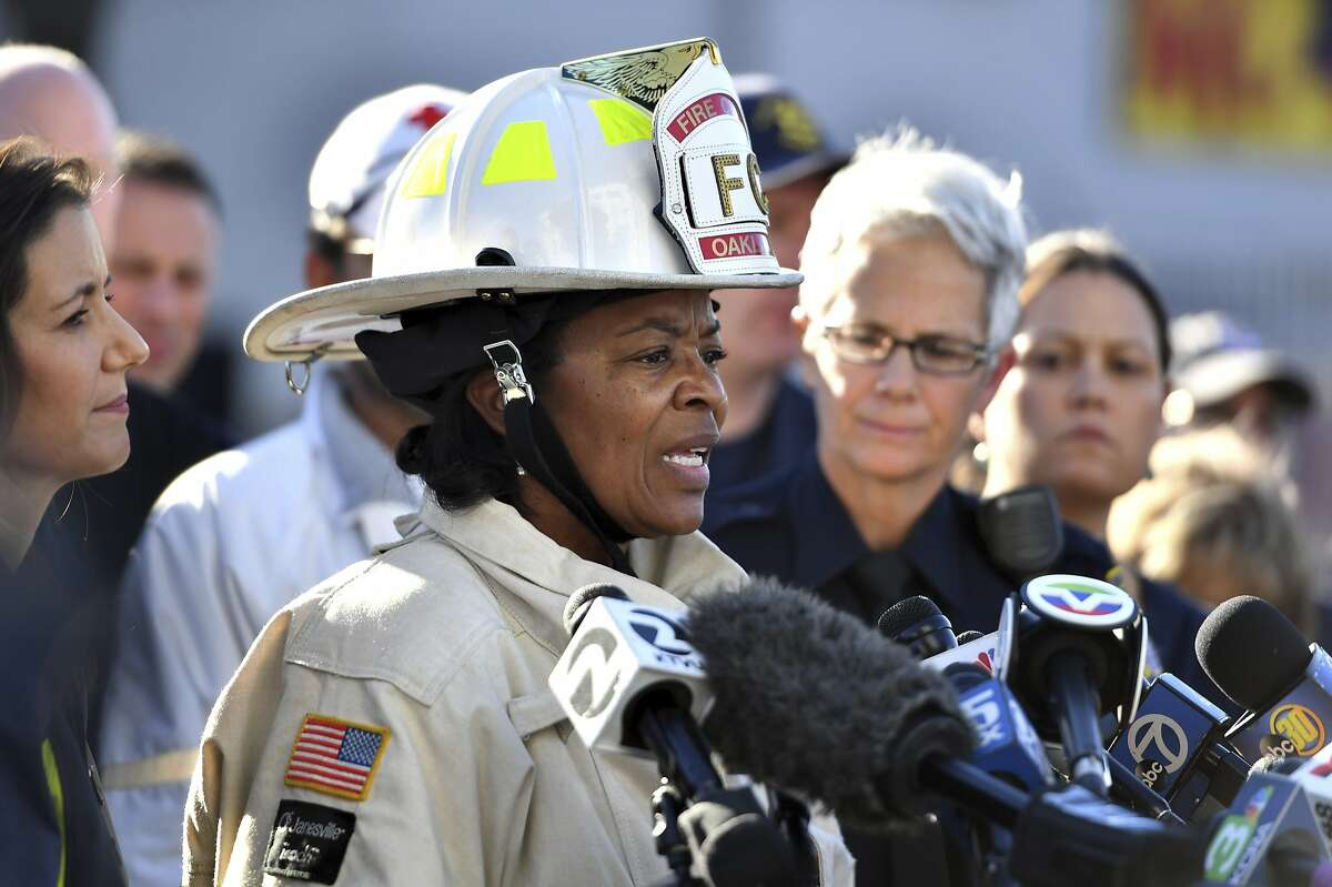 Oakland Fire Chief Teresa Deloach Reed speaks to members of the media after a deadly fire tore through a warehouse during a late-night electronic music party in Oakland, Calif., Saturday, Dec. 3, 2016. Officials described the scene inside the warehouse, which had been illegally converted into artist studios, as a death trap that made it impossible for many partygoers to escape the Friday night fire. (AP Photo/Josh Edelson)