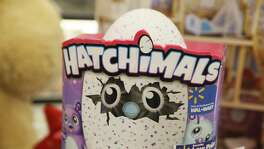 The Hatchimals Hatching Egg toy is displayed with Black Friday specials at a Wal-Mart Stores Inc. location in Burbank, California, U.S., on Tuesday, Nov. 22, 2016. Consumer hardline retailers are hopeful Black Friday will provide a strong start to the holiday shopping season, but any lift may come at the expense of margins, as the landscape has become increasingly promotional. Photographer: Patrick T. Fallon/Bloomberg