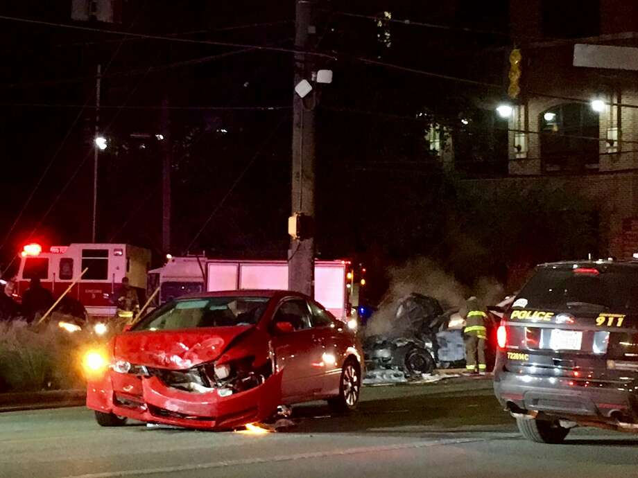 A car caught fire after a collision near the intersection of Broadway Street and Brackenridge Avenue. Photo: Cory Heikkila