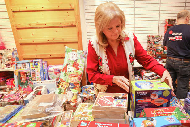 Volunteer Robin Massey-Crozier organizes donations for the Salvation Army on Friday, Dec. 9, 2016, at the Outlets at Conroe.