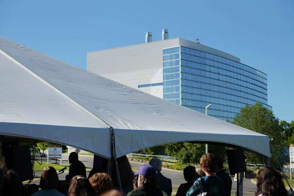 Robert Jones, president of the University at Albany, speaks under a tent at an event at the University at Albany's East Campus on Monday, Sept. 12 2016, in East Greenbush, N.Y.  The college announced that the East Campus will now be called the UAlbany Health Sciences Campus.  In the background is the Cancer Research Center.     (Paul Buckowski / Times Union)
