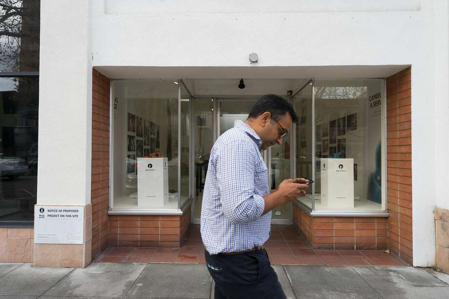 A man walks past the new Relonch office in Palo Alto. Relonch is a company that offers customers a monthly subscription to cloud-based storage as well as automated image processing. The service also comes with a free point-and-shoot camera. Photo: James Tensuan, Special To The Chronicle