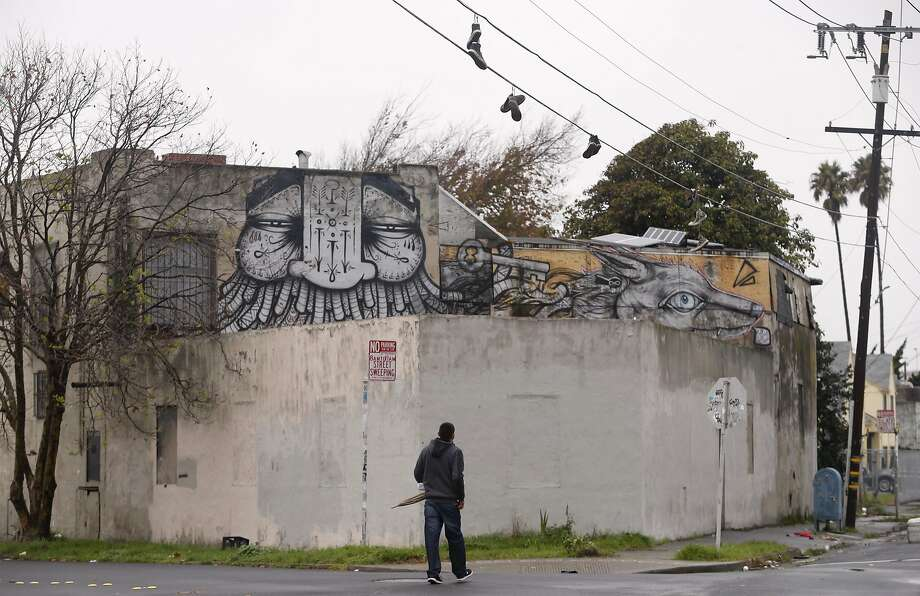 A man walks past the Burnt Ramen underground music club on Espee Avenue in Richmond, Calif. on Friday, Dec. 9, 2016. Mayor Tom Butt described the venue as Richmond's version of the Ghost Ship, the Oakland artist collective where 36 people died in a fire during an electronic music party last weekend. Photo: Paul Chinn, The Chronicle