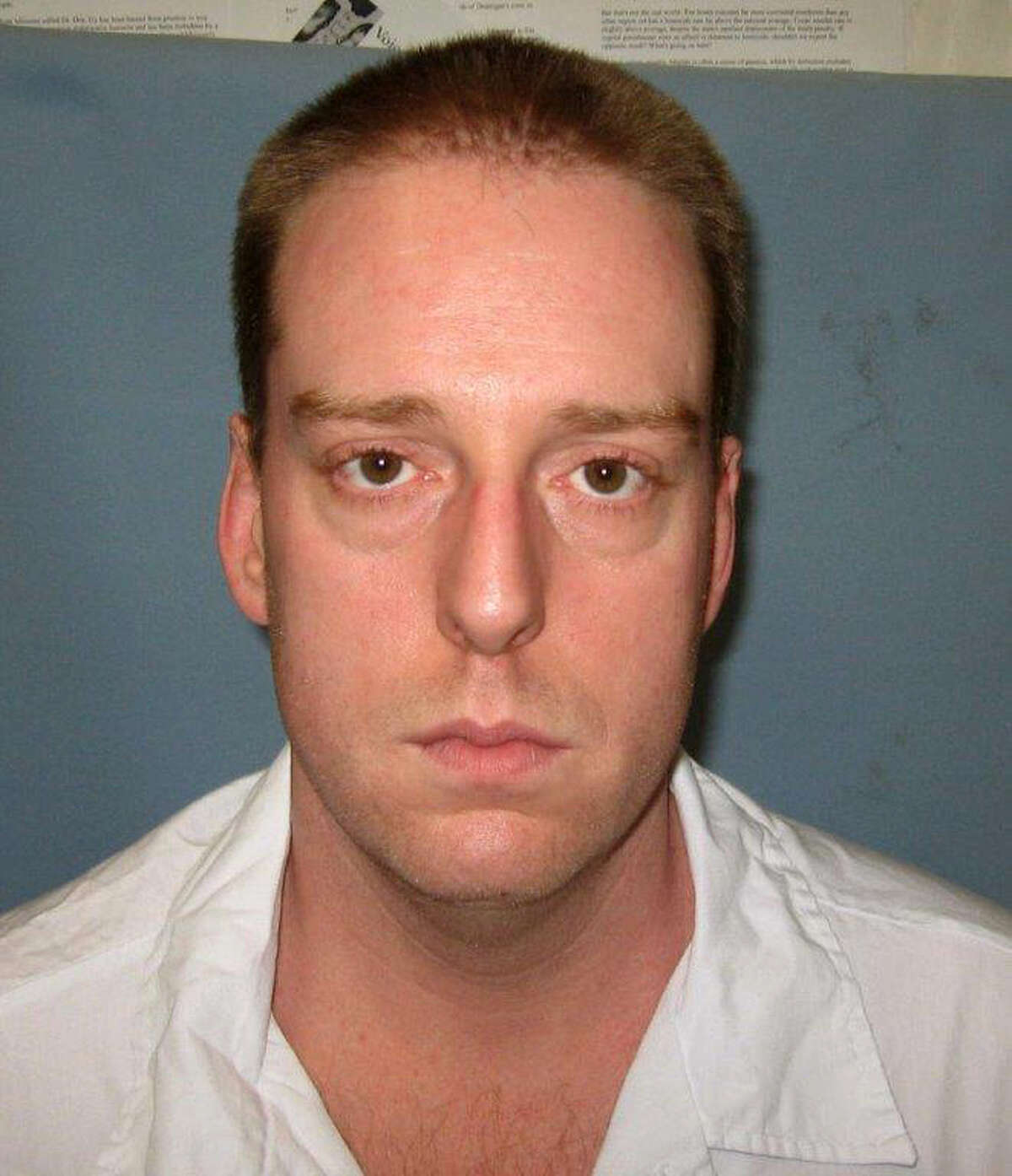 FILE - This undated photo provided by the Alabama Department of Corrections shows Ronald Bert Smith Jr.. Smith Jr., an Alabama inmate coughed repeatedly and his upper body heaved for at least 13 minutes during an execution, Thursday, Dec. 8, 2016, using a drug that has previously been used in problematic lethal injections in at least three other states. (Alabama Department of Corrections via AP, File)