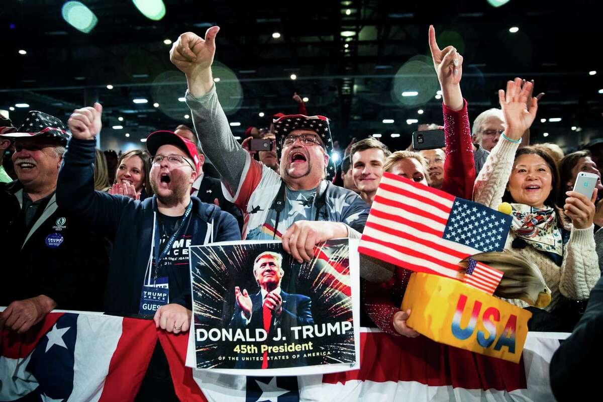 """Supporters cheer during president-elect Donald Trump's """"Thank You"""" rally in Des Moines, Iowa, Dec. 8, 2016. Trump brought Gov. Terry Branstad of Iowa, his choice for ambassador to China, on stage during the event. (Doug Mills/The New York Times)"""