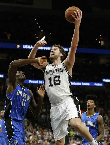 Spurs' Pau Gasol (16) shoots against the Orlando Magic's Bismack Biyombo (11) during their game at the AT&T Center on Tuesday, Nov. 29, 2016. (Kin Man Hui/San Antonio Express-News) Photo: Kin Man Hui, Staff / San Antonio Express-News / ©2016 San Antonio Express-News