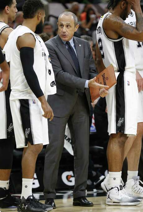 Spurs' assistant coach Ettore Messina (center) talks with Patty Mills (08) during the game against the Orlando Magic  at the AT&T Center on Tuesday, Nov. 29, 2016. (Kin Man Hui/San Antonio Express-News) Photo: Kin Man Hui, Staff / San Antonio Express-News / ©2016 San Antonio Express-News